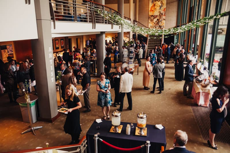 Cornish playhouse lobby is filled with guests mingling during cocktail hour