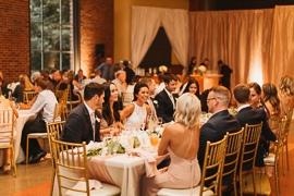 a wedding party sits at the head table together