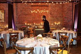 A server sets up the room at melrose market studios