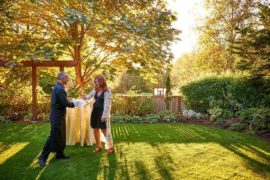 A server attends to a guest in a garden area