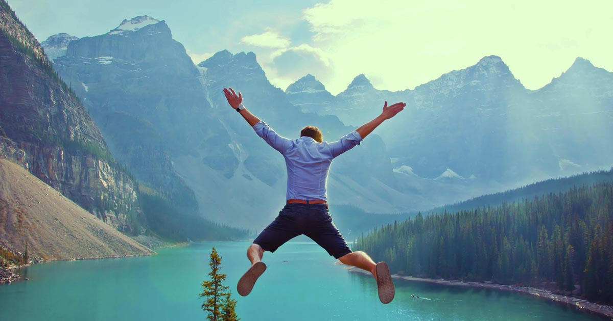 Person jumping with a nice view