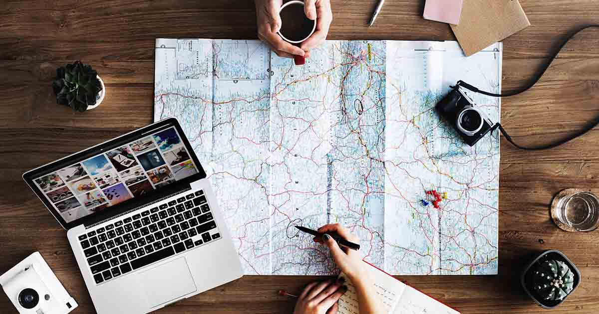 planning a trip using a paper map