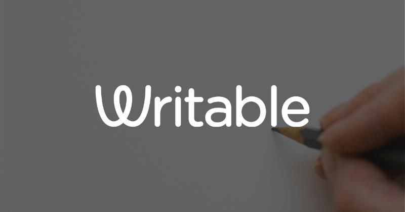 hand holding pen behind Writable logo