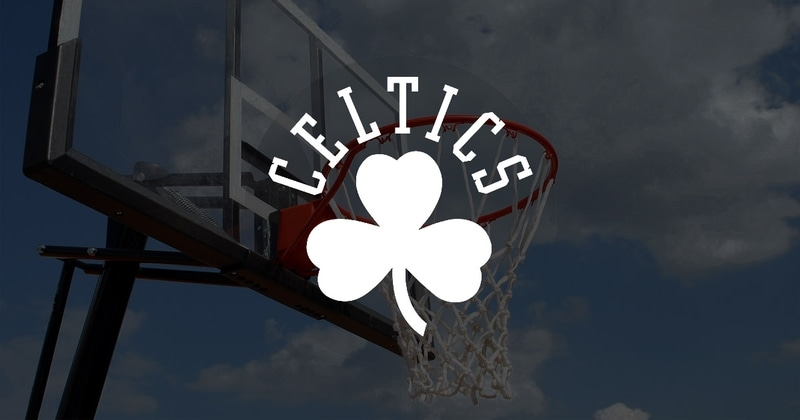 Boston Celtics logo in front of a basketball hoop