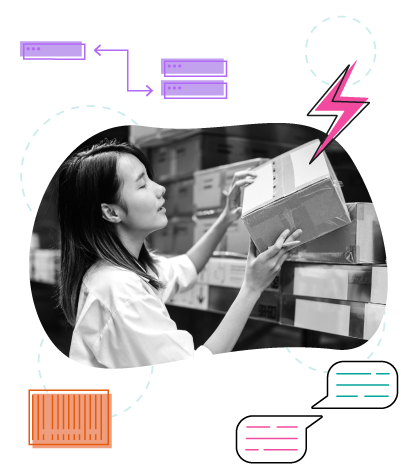 female worker checking products/boxes in large warehouse