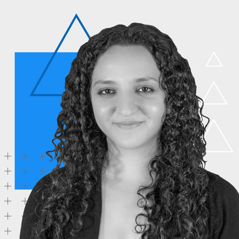 Woman with long dark curly hair with colored square and triangles behind her