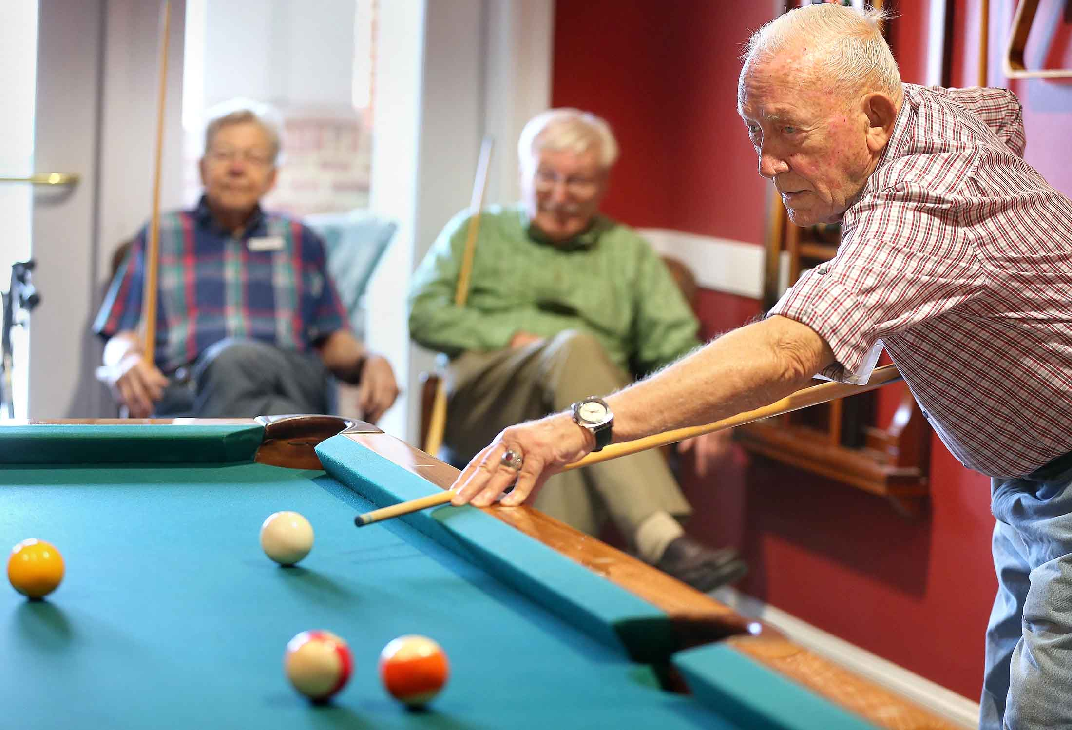 gentlemen playing billiards