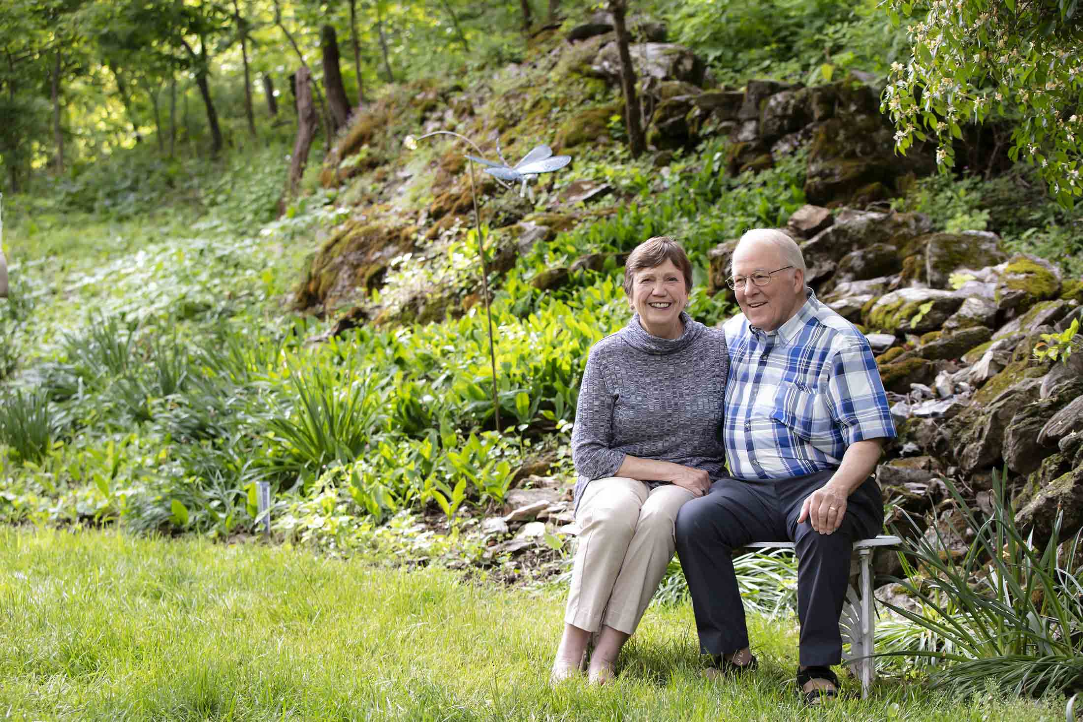 couple sitting in green landscape