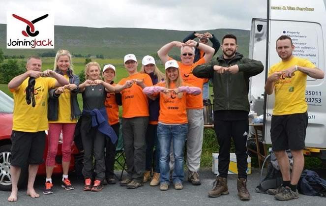 Hikers celebrating taking on the 3 Peaks Challenge