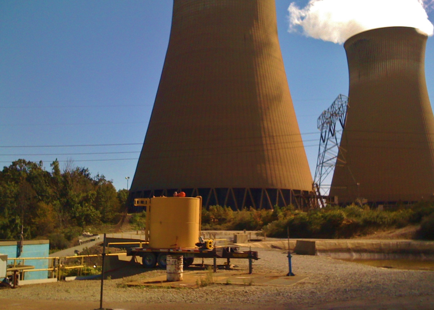 View of storage tank with nuclear power plants in the background