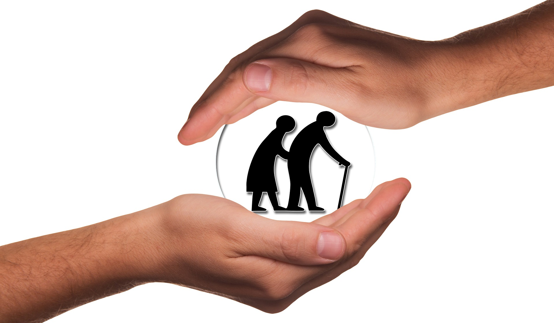 Twee naar elkaar reikende handen waarin twee silhouetten van oudere mensen steun vinden.