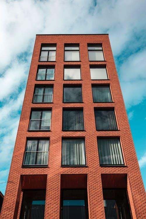 Red and Black Concrete High-rise Building