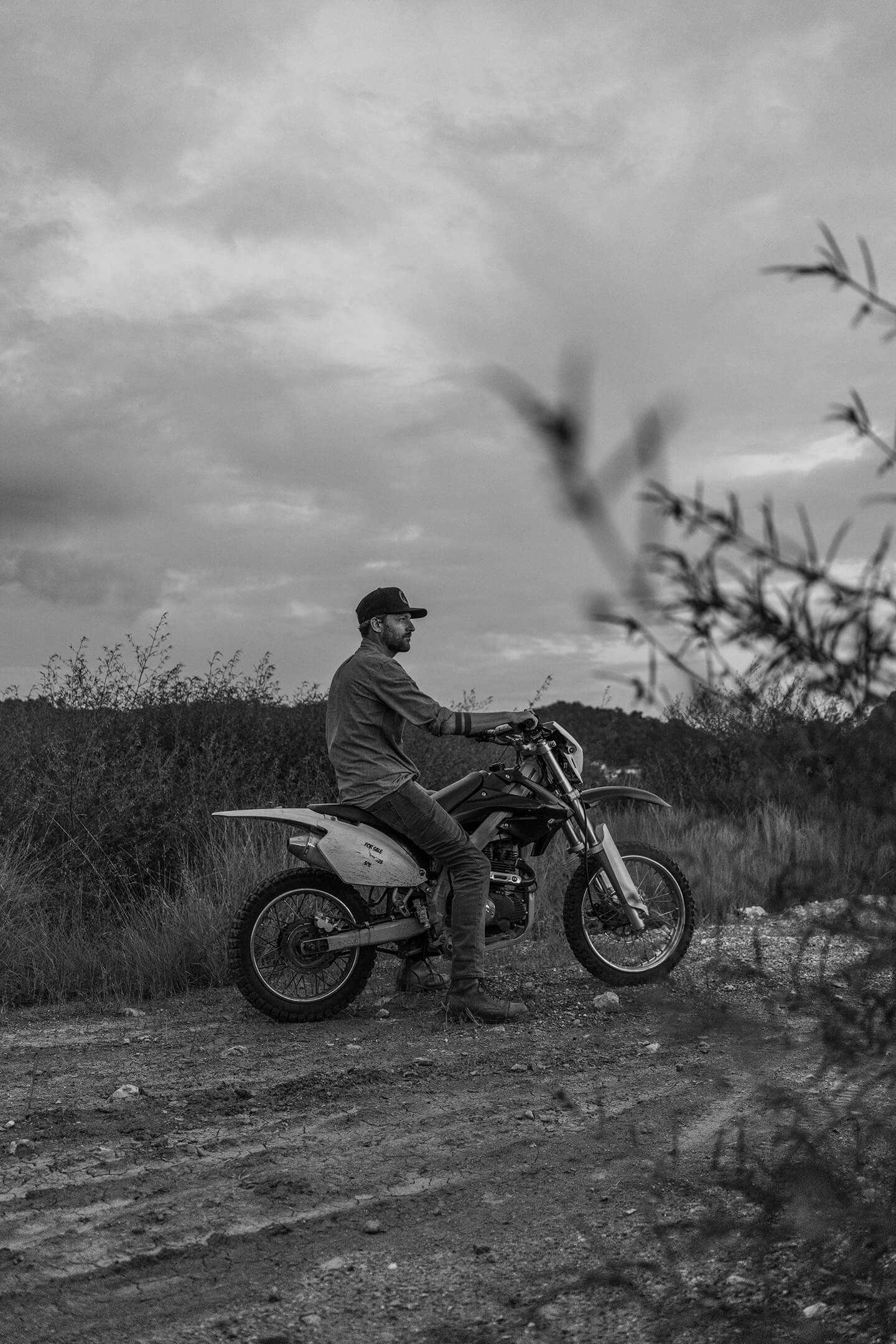 Jon Rose, Founder of Waves for Water, on a motorbike