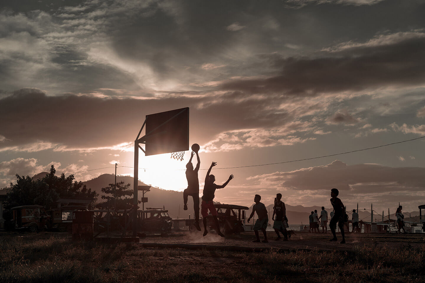 Locals and volunteers alike play basketball after a long day.