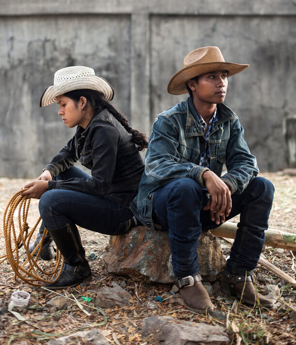 Masbate Rodeos dressed in full cowboy regalia-- denim, hats, boots, whip rope in tow.