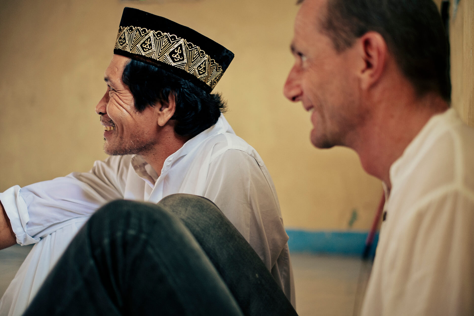 Imam Eldio and Wolfgang Dafert smiling