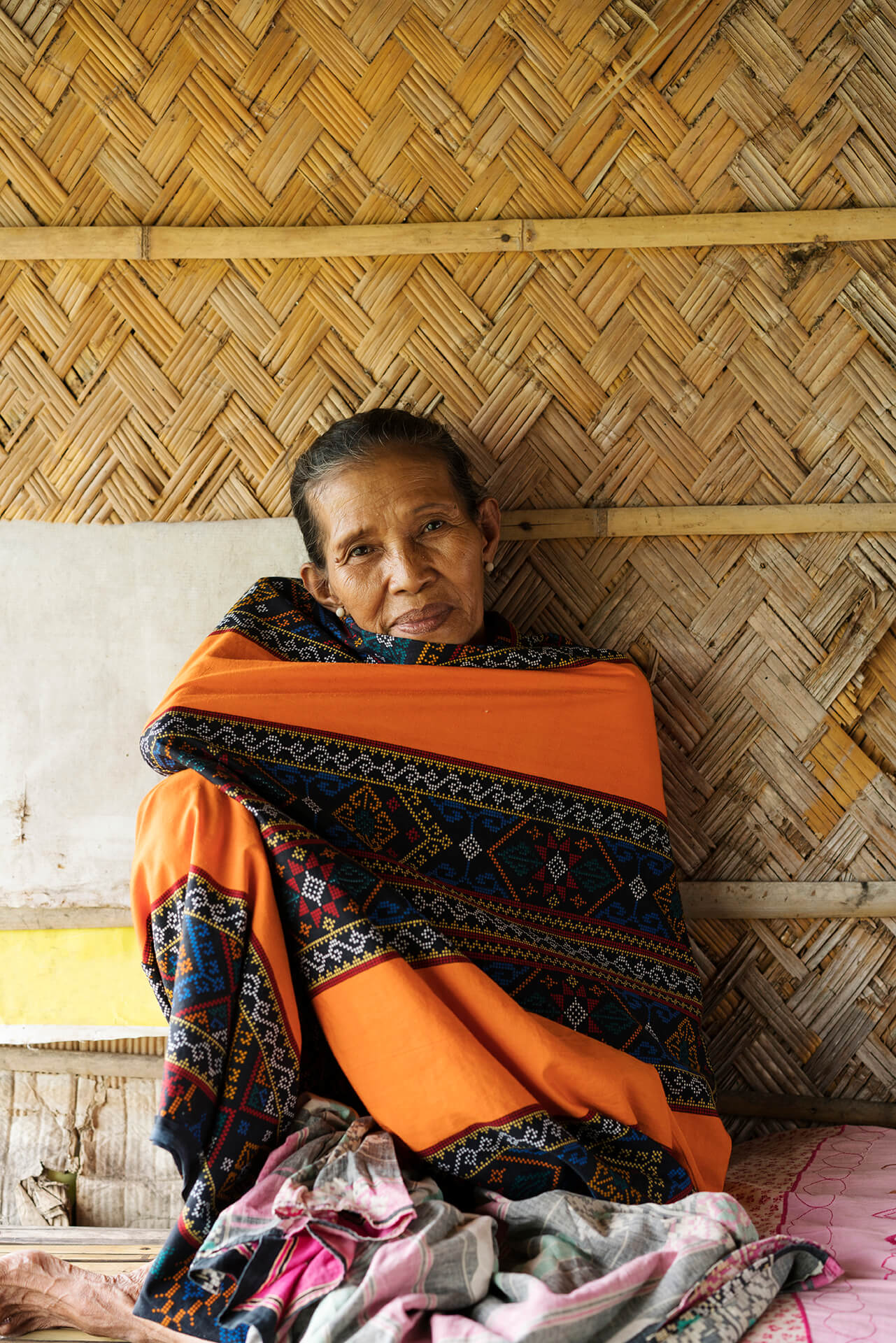 a Maguindanaoan woman wrapped in a tribal-designed fabric.