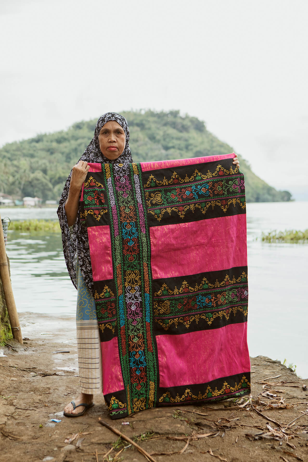 Maranao textile forming intricate okir patterns in panels of three