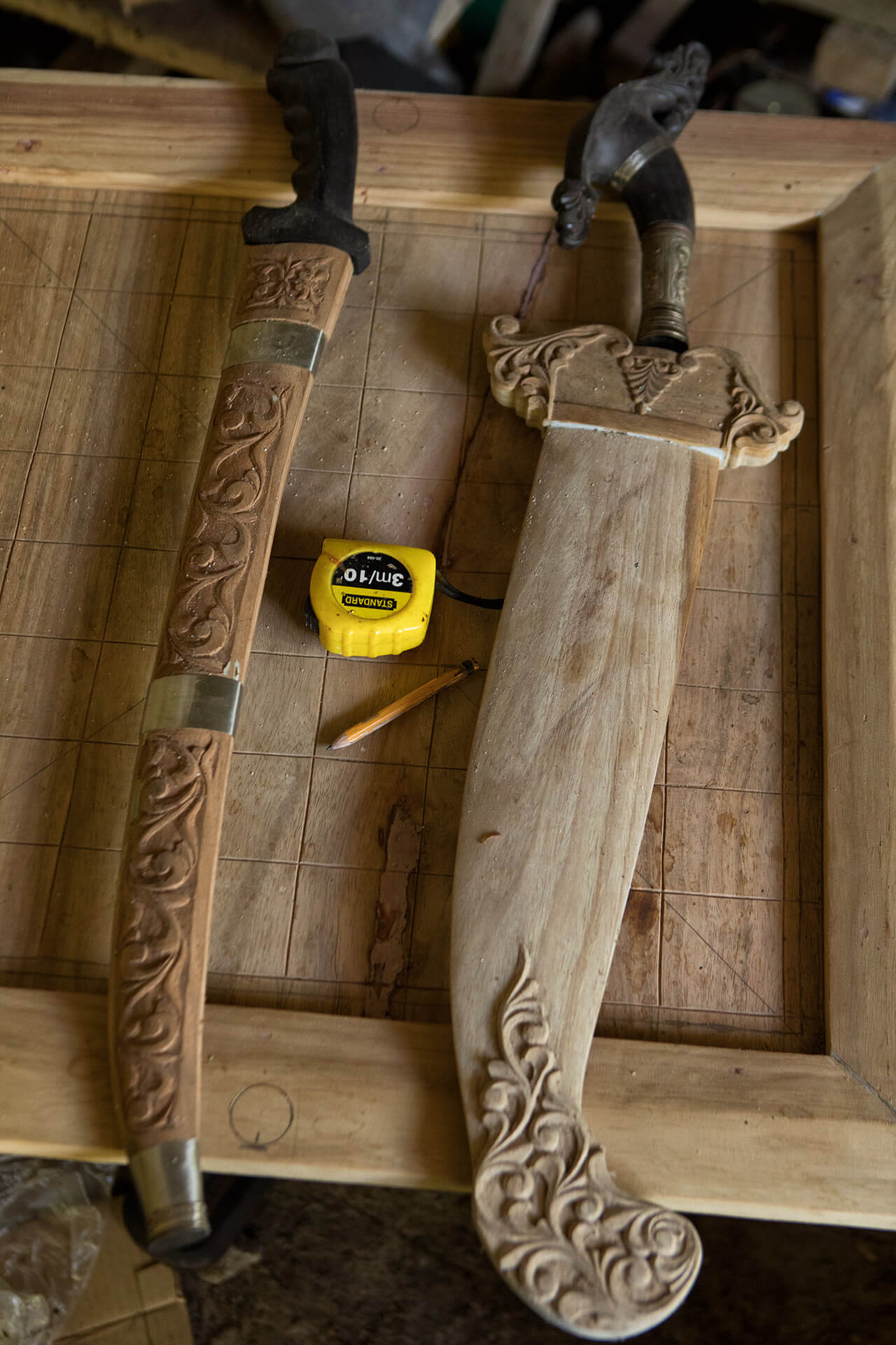Wooden bolo sheaths with carved ornamental patterns as a signature Marawian art.