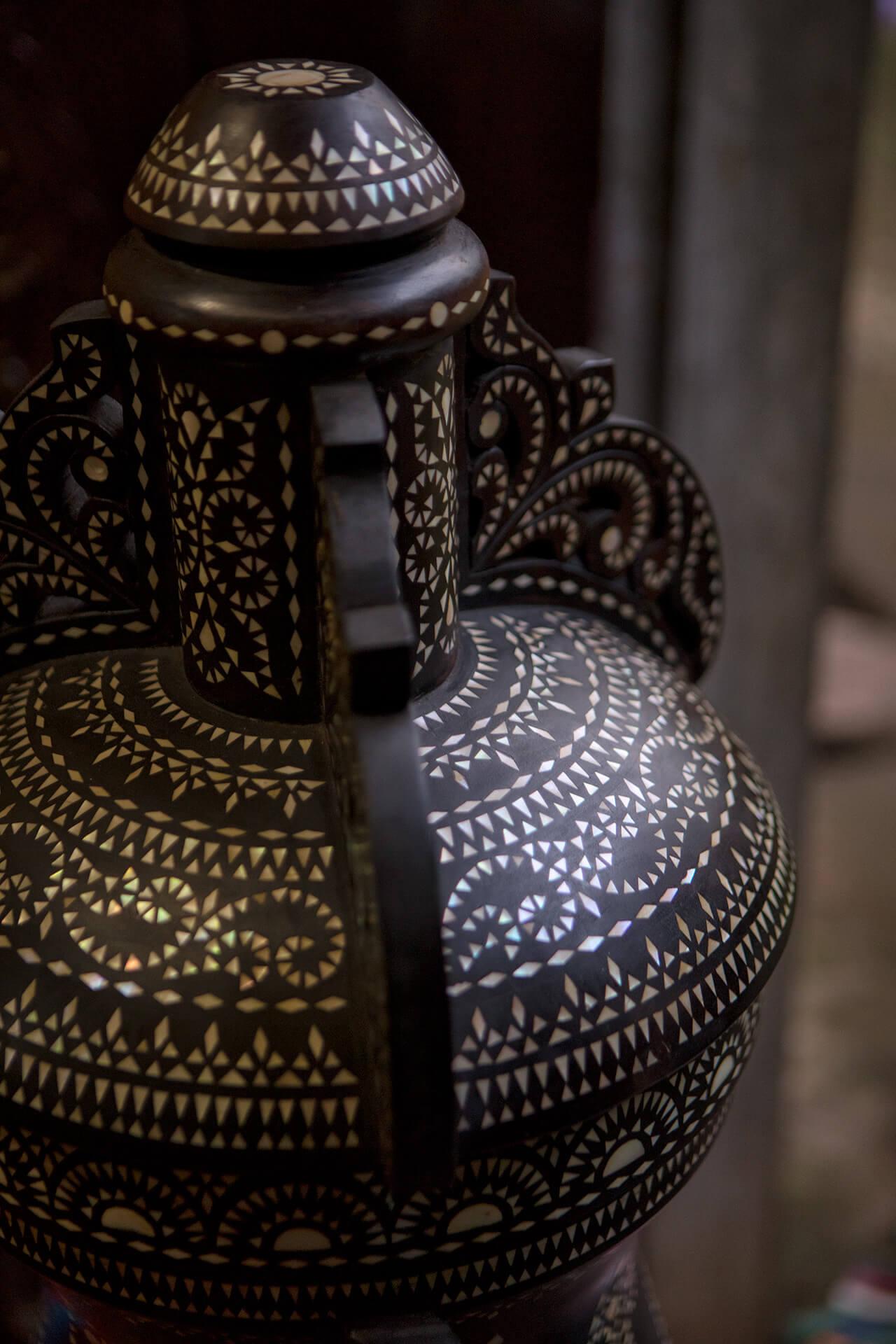 Intricate okir patterns in capiz on a vase