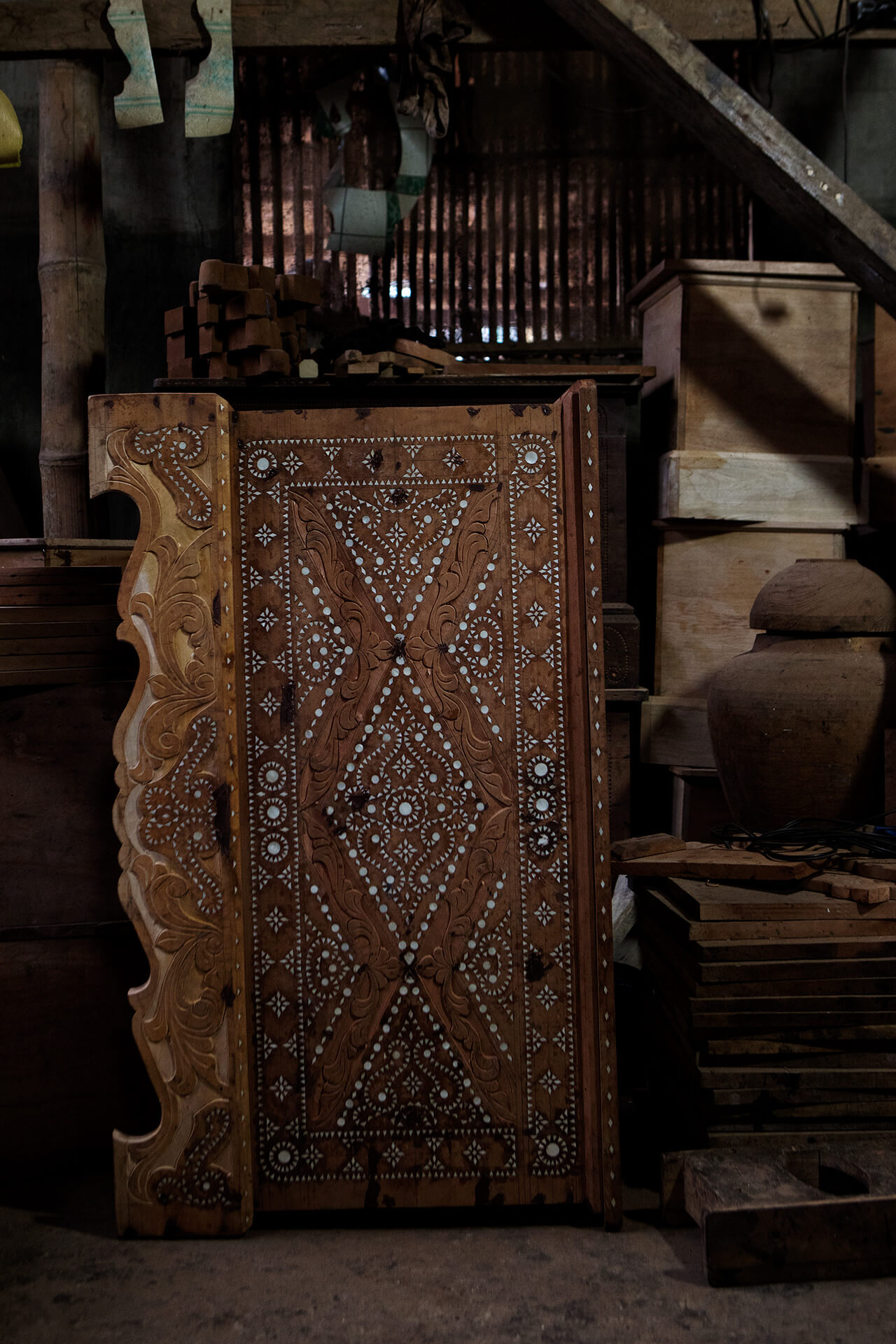 A large cabinet with mother-of-pearl inlays tracing the intricate okir patterns