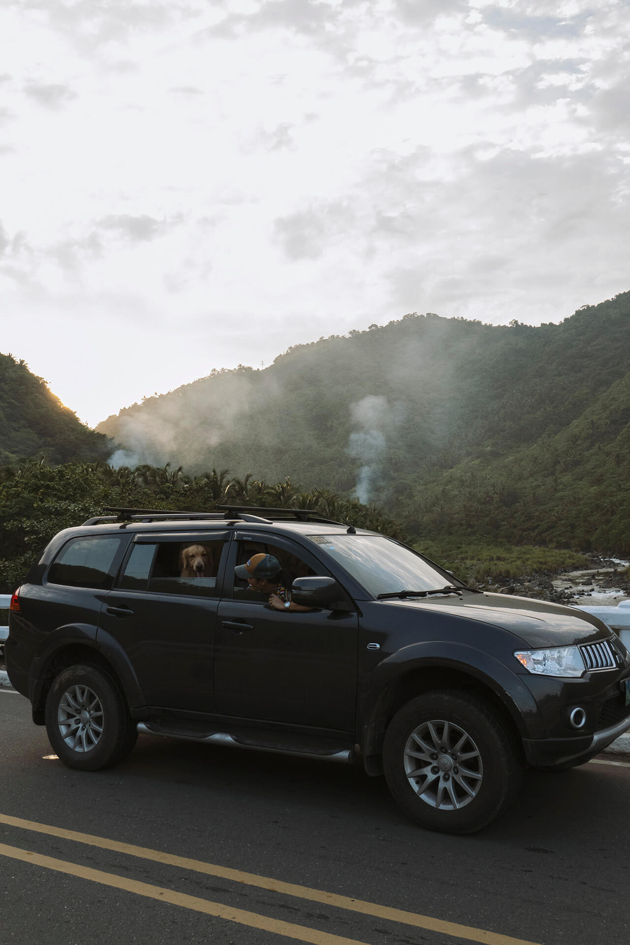 Mike Dee drives with his dogs to Tanay, Rizal.