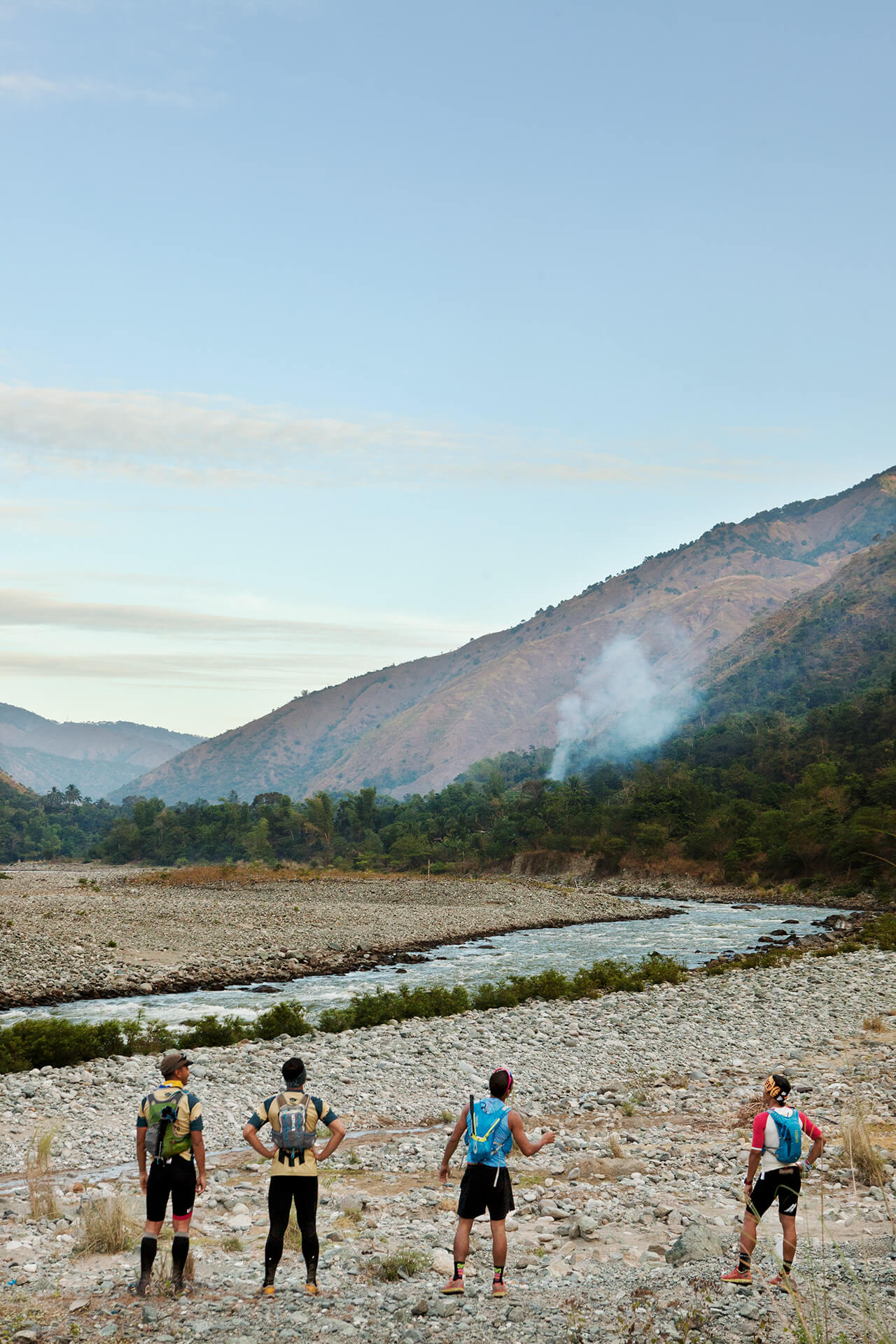 A group of mountain ultra runners taking a break to grasp the beauty of the landscape.