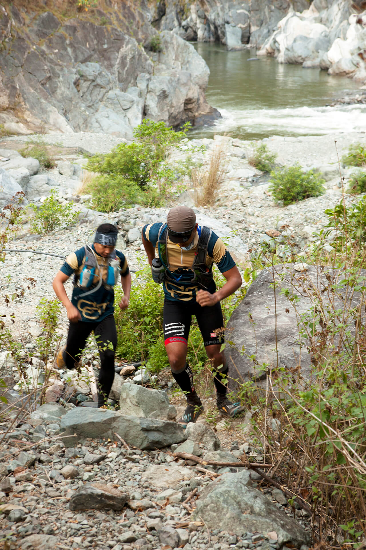 Two mountain runners going up the trail