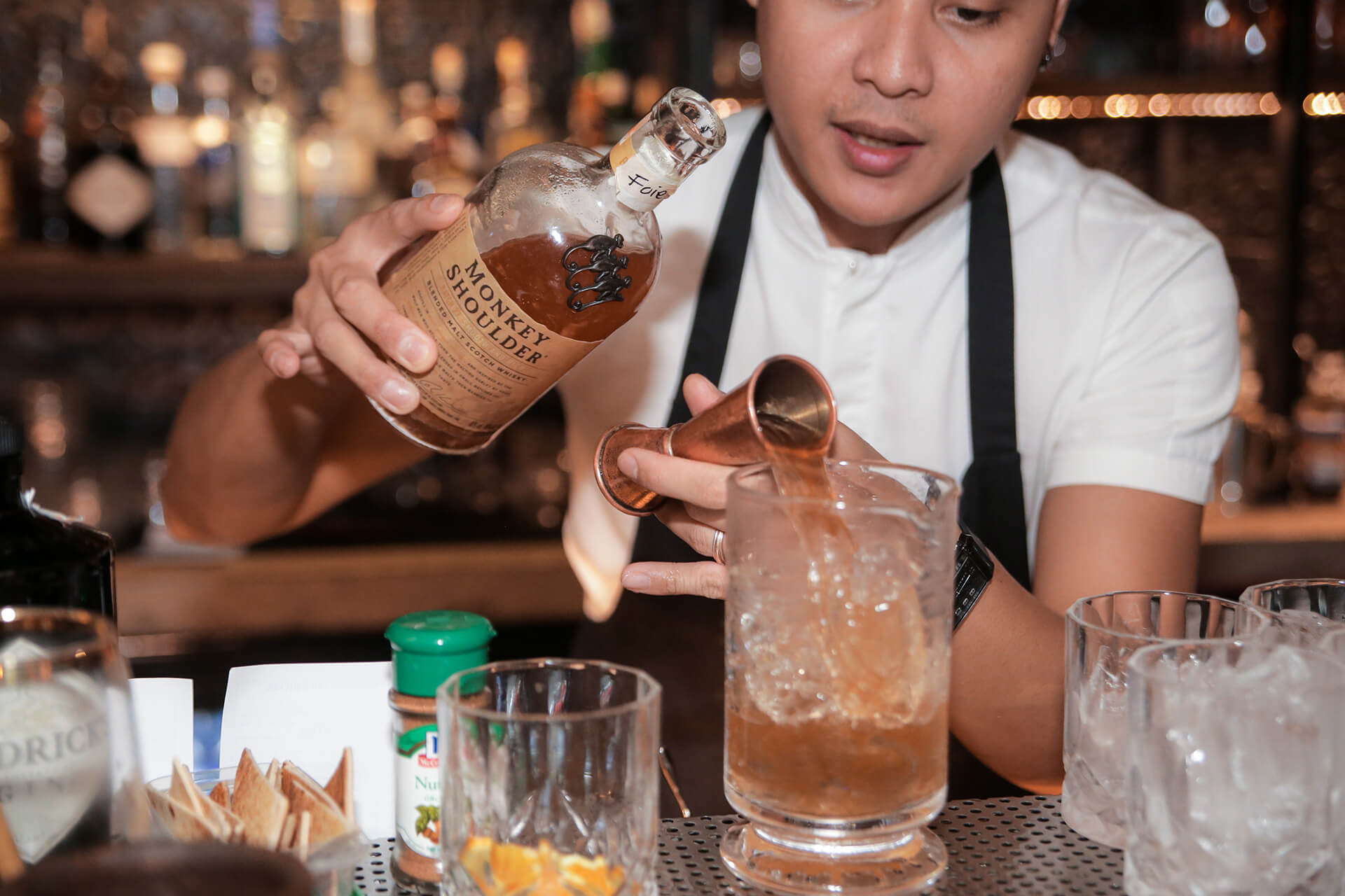 Mel Chavez of Tippling Club Singapore makes a cocktail with Monkey Shoulder whisky at Agimat Bar