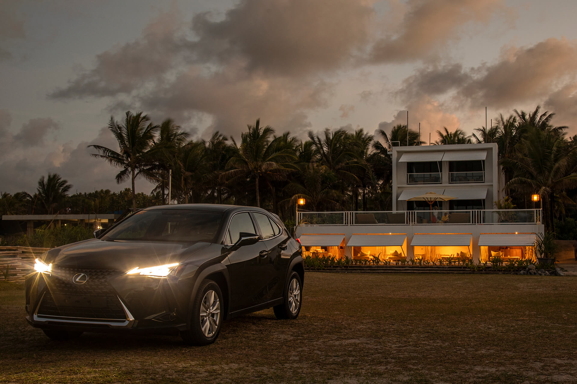The Lexus UX photographed in front of Siama Surf at sunset.