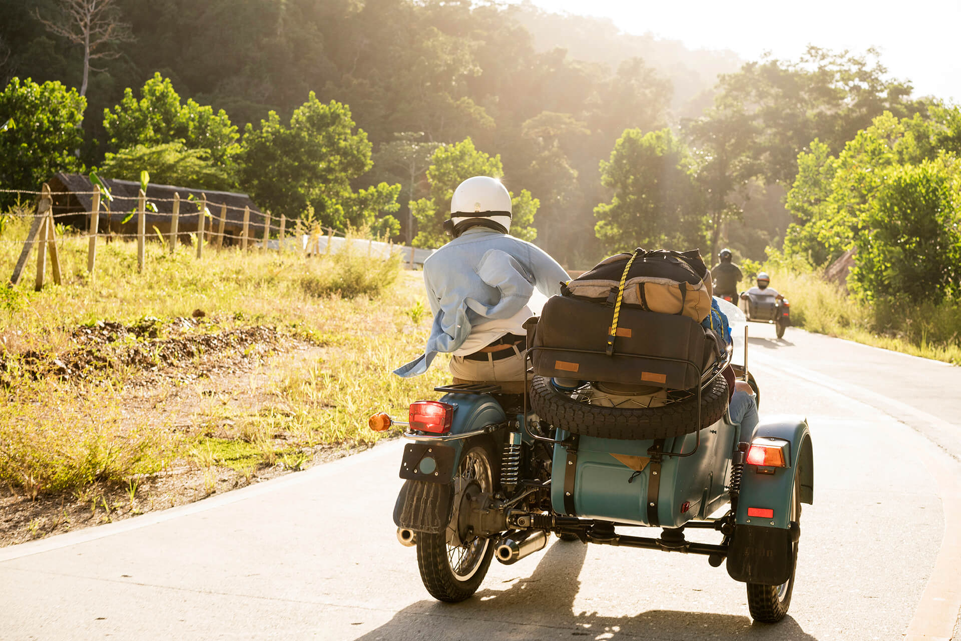 On the road to San Vicente aboard a Ural at 100 kph; gear safely stowed away.