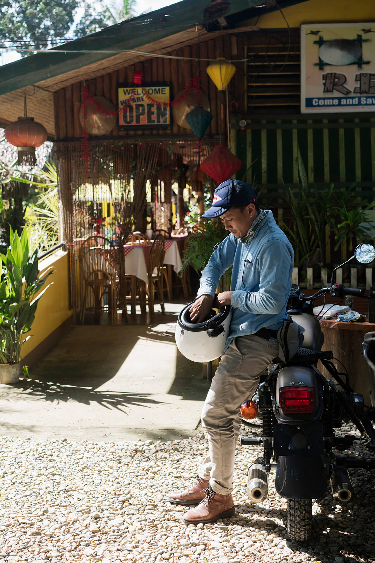 A Ural rider stops over for lunch at an iconic carinderia.