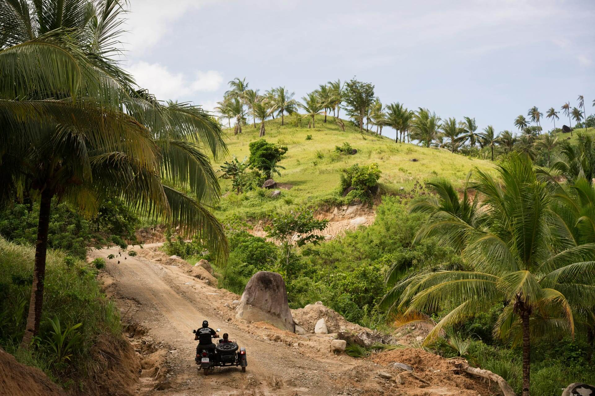 The under-appreciated Ural with its 749 cc engine capacity powers up a rugged hill.