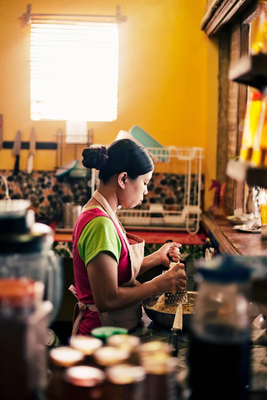 A woman prepares ingredients at Spicebird Boracay