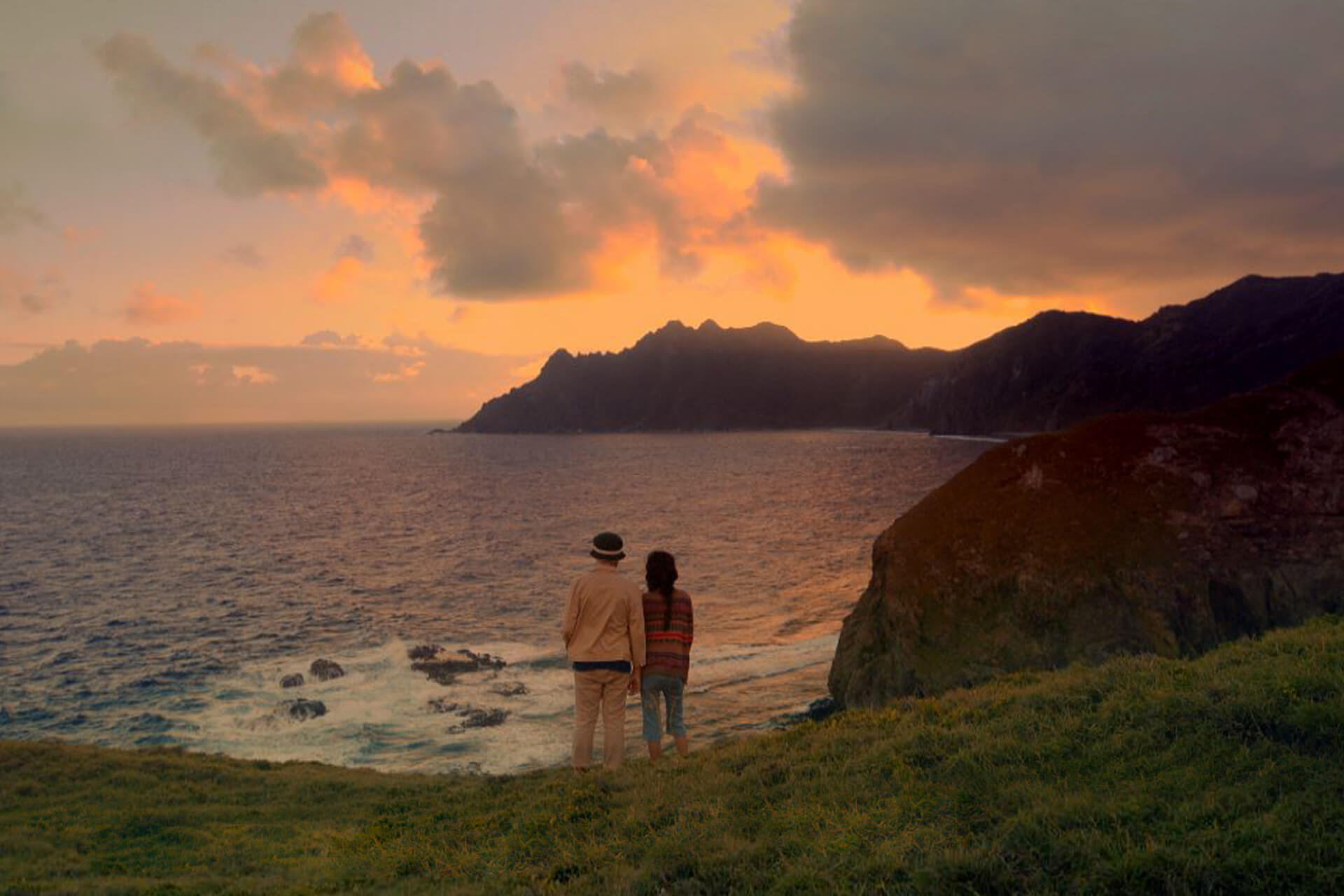 Sol and Benjie overlooking the horizon by the beach