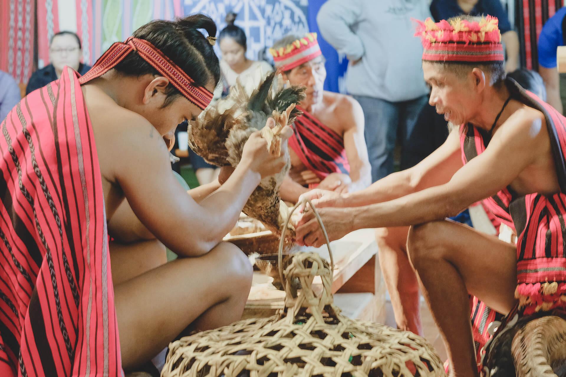 The mumbaki preparing the chicken sacrifice ritual.