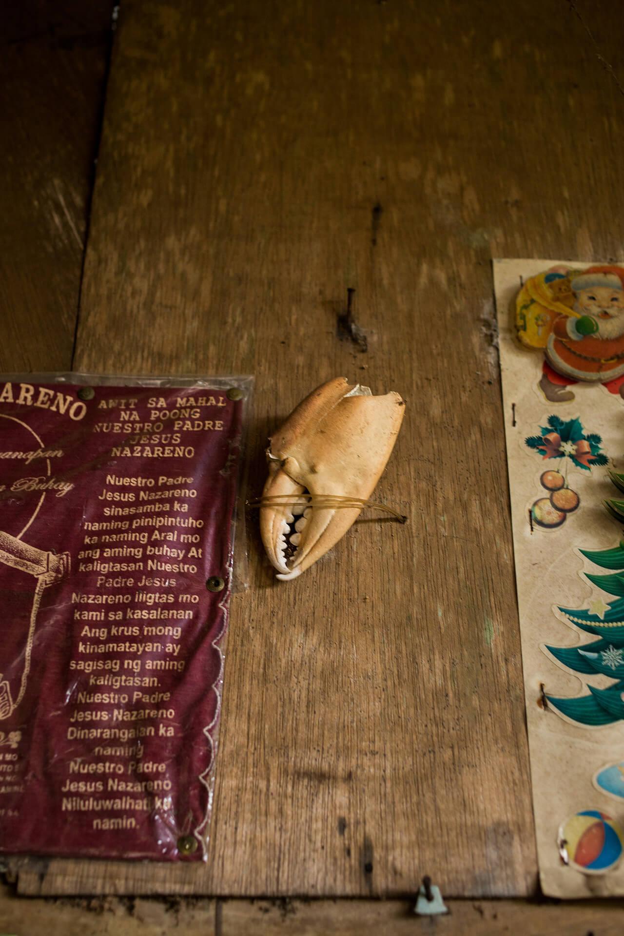 A Nazareno handkerchief, crab claw talisman, and Christmas decor