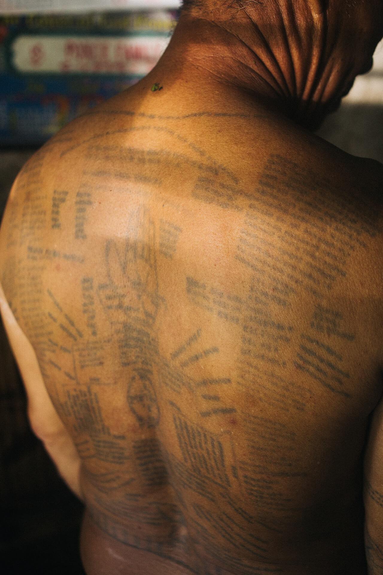 Quirino's back also boasts of elaborate patik (tattoo) of orasyones
