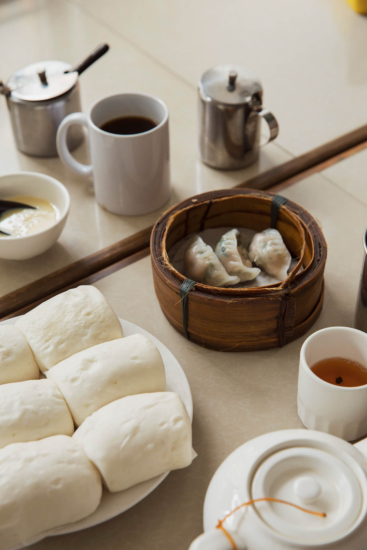 Cuapao buns and dumplings with hot tea at Ying-Ying Tea House.