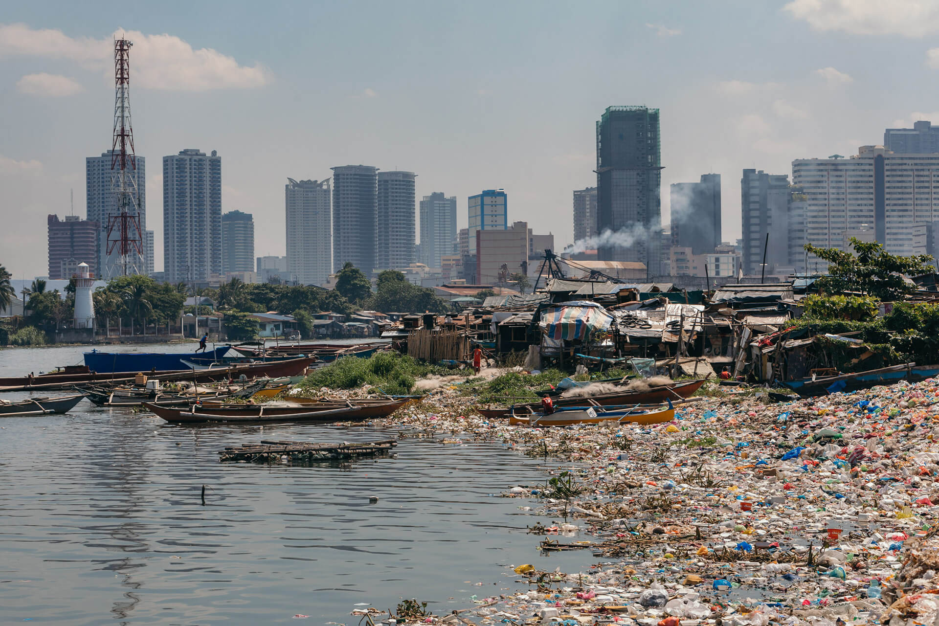 Pools of trash have collected along the banks of Manila Bay