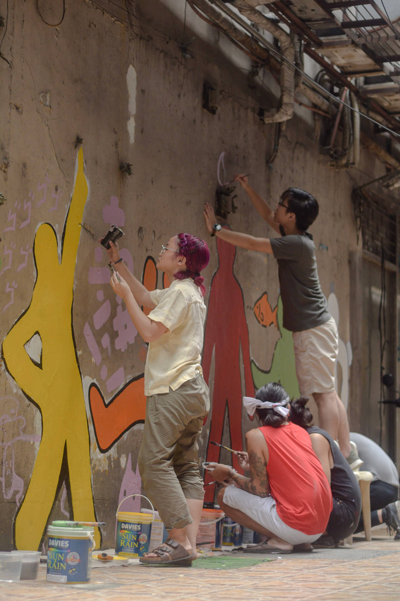 Local artists painting a mural along Carvajal Street