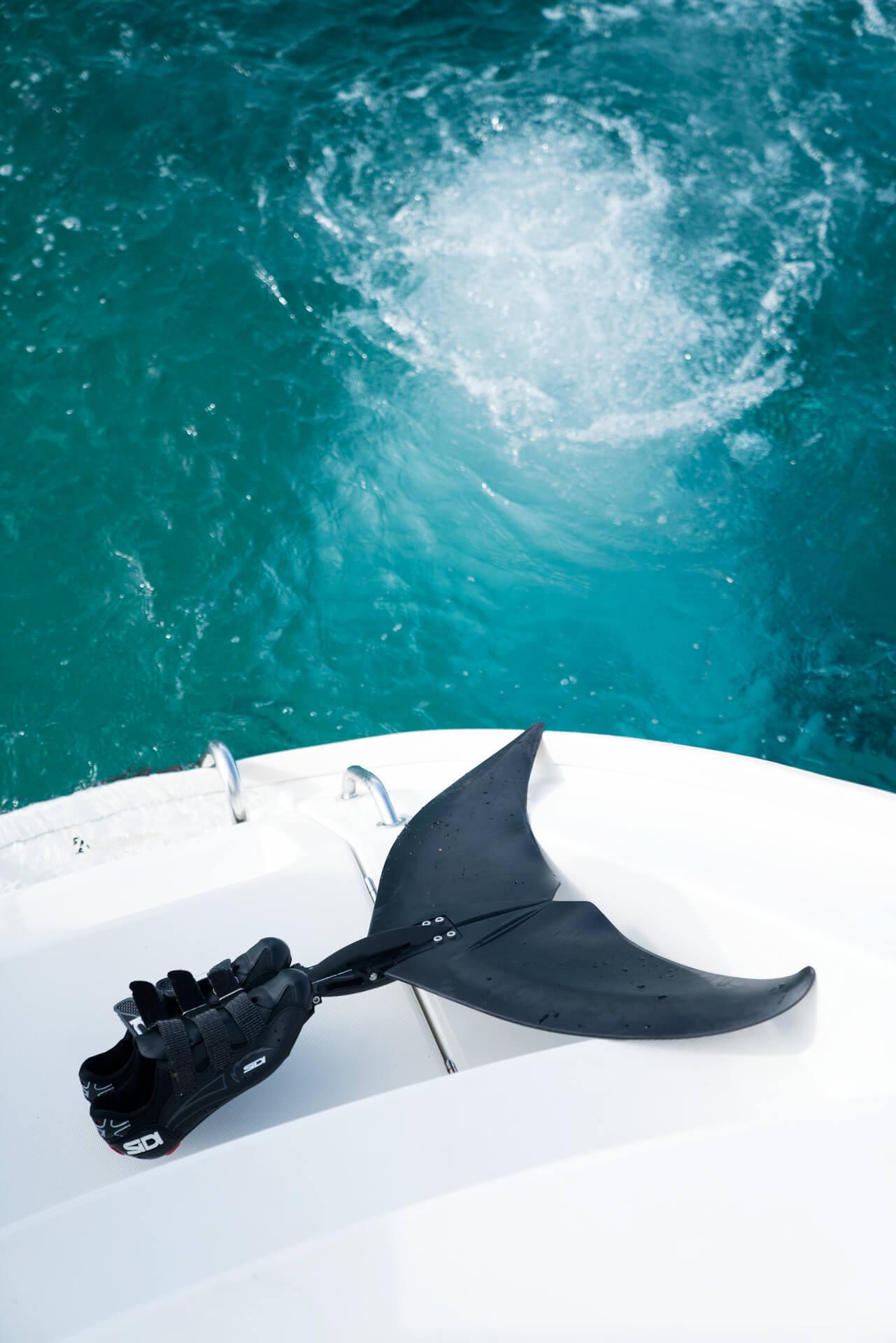 monofin atop a boat