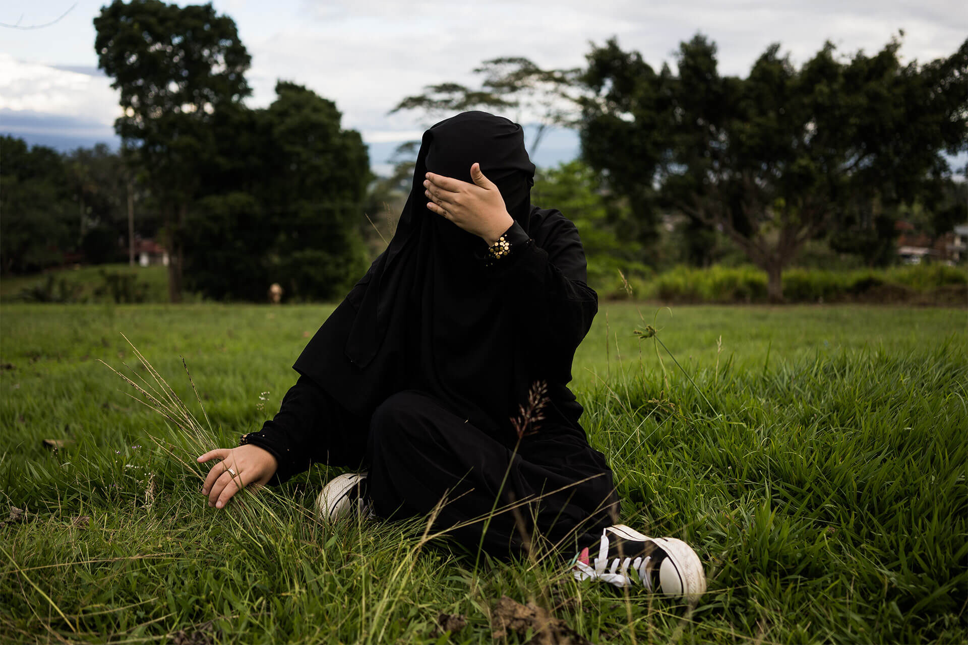 Moro Woman wearing Islamic veil covers her face