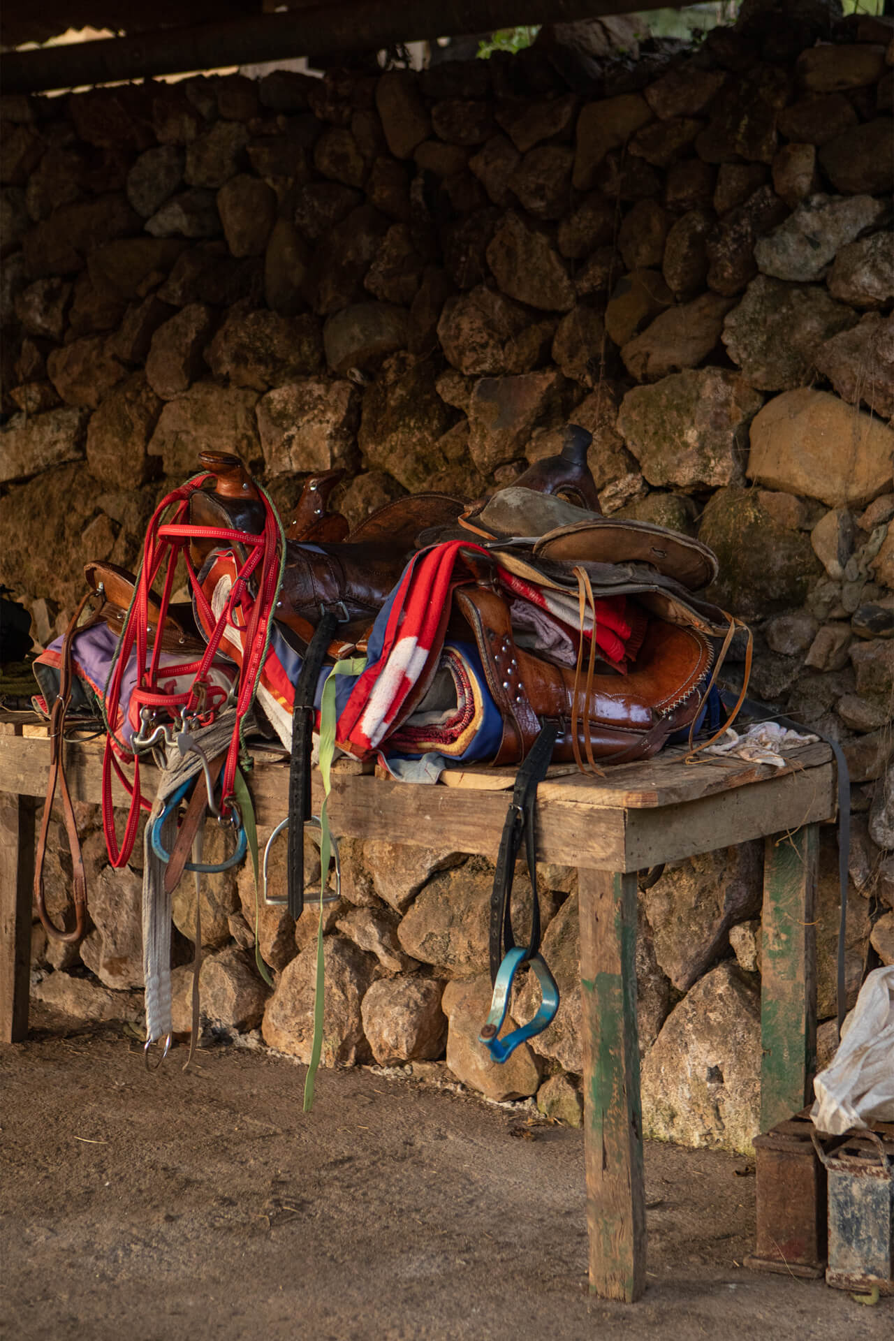A pile of horseriding saddles ready for use