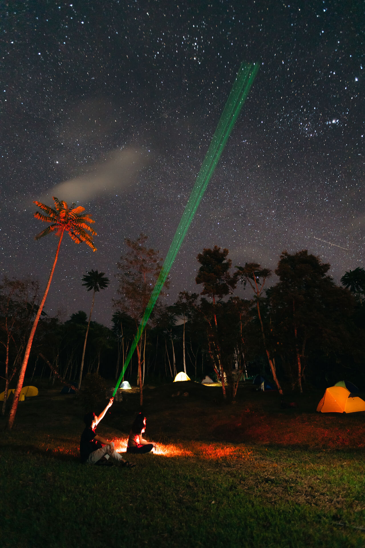 A member of the Philippine Astronomical Society points a laser at the stars