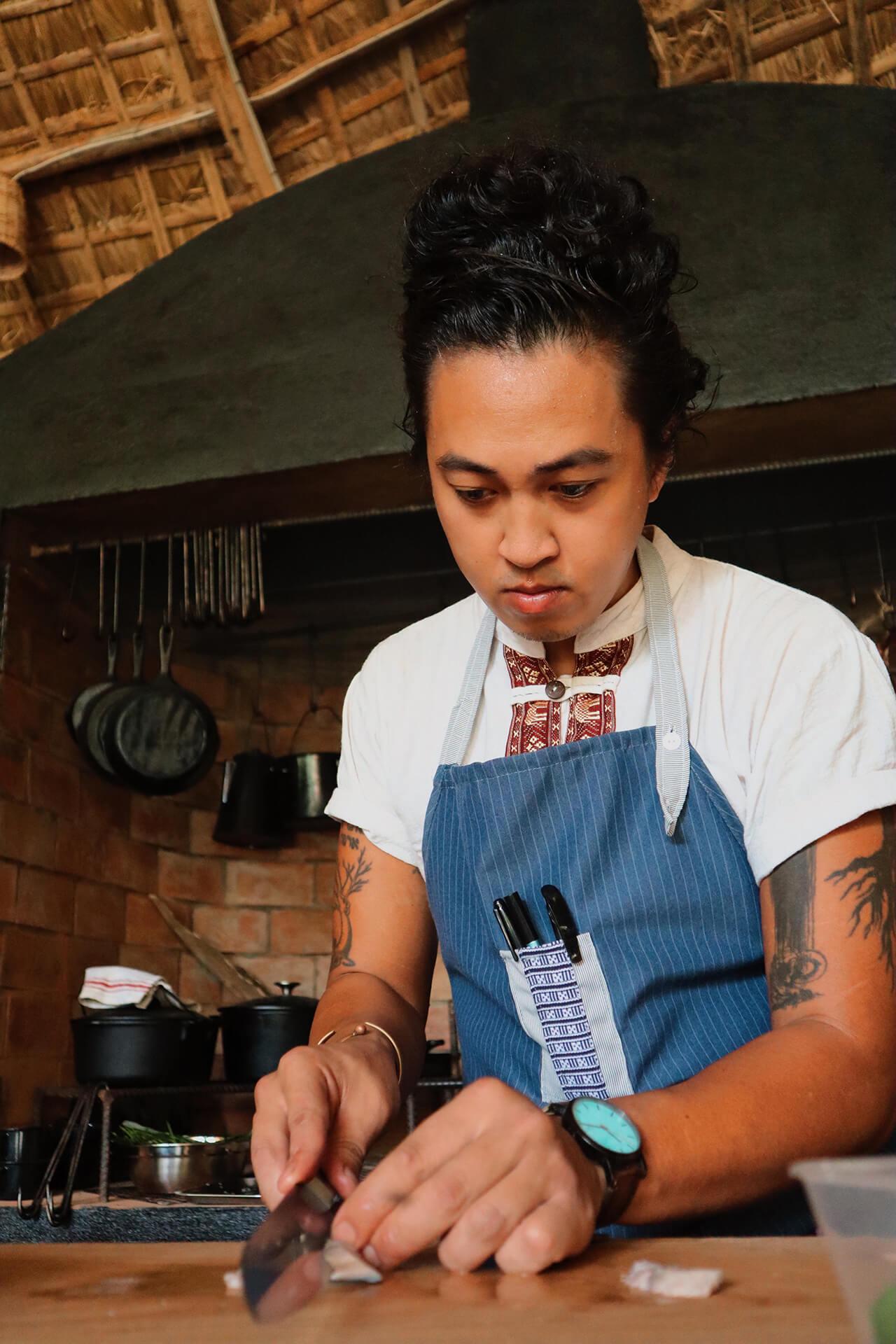 Chef Ken Cazeñas works in the kitchen at Alpas