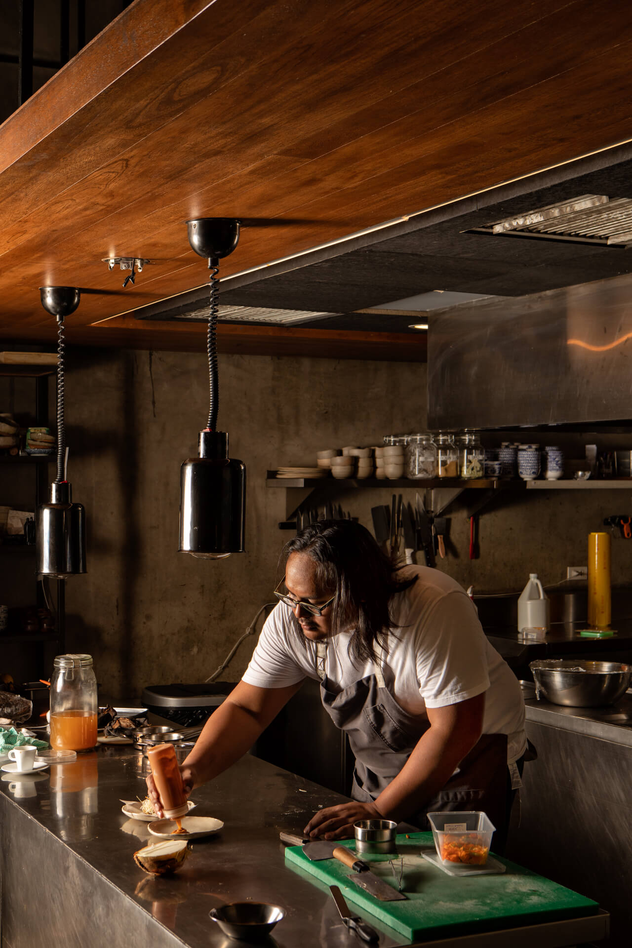 Chef Jordy Navarra plating a dish at Toyo Eatery