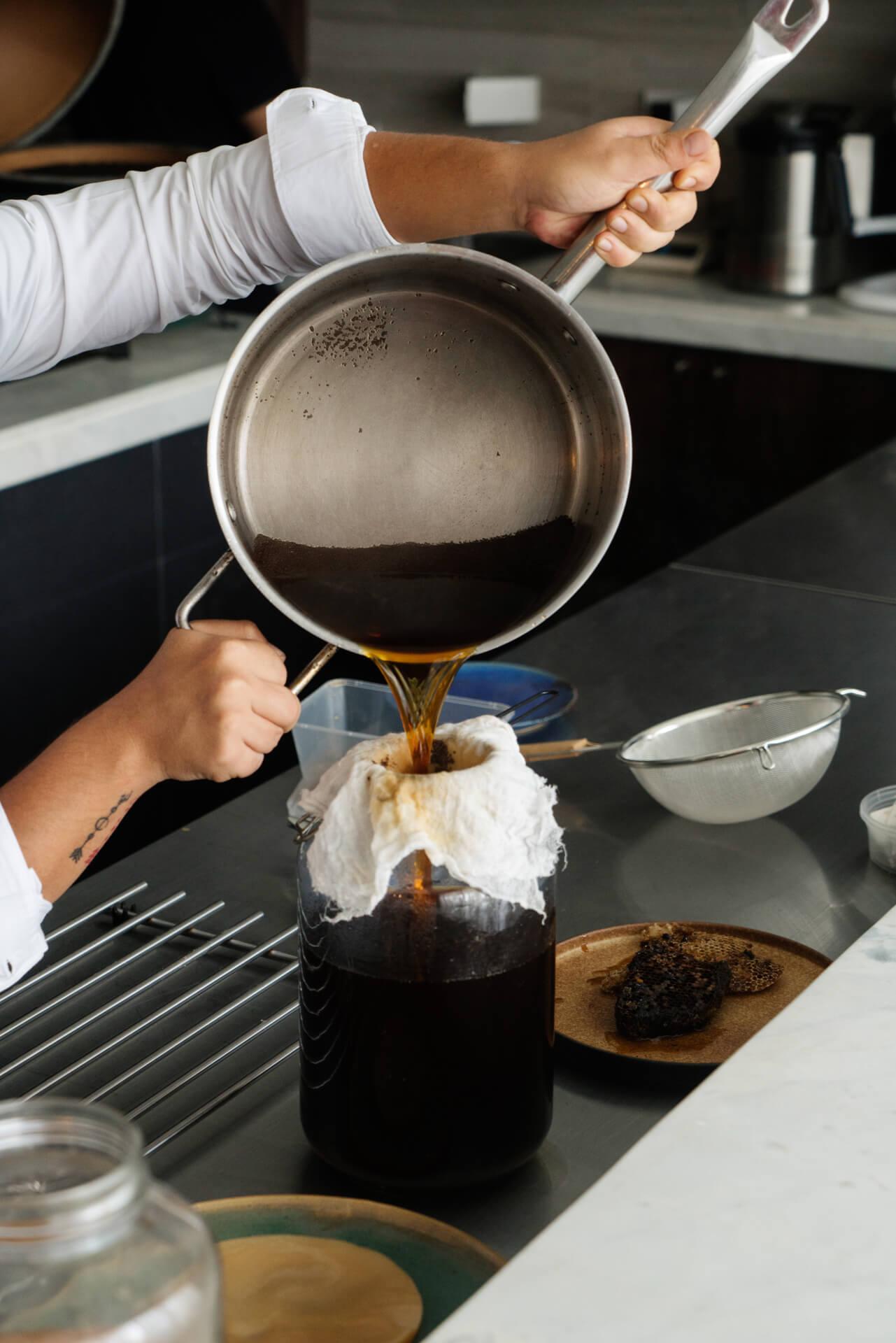 Chef Josh Boutwood preparing kombucha