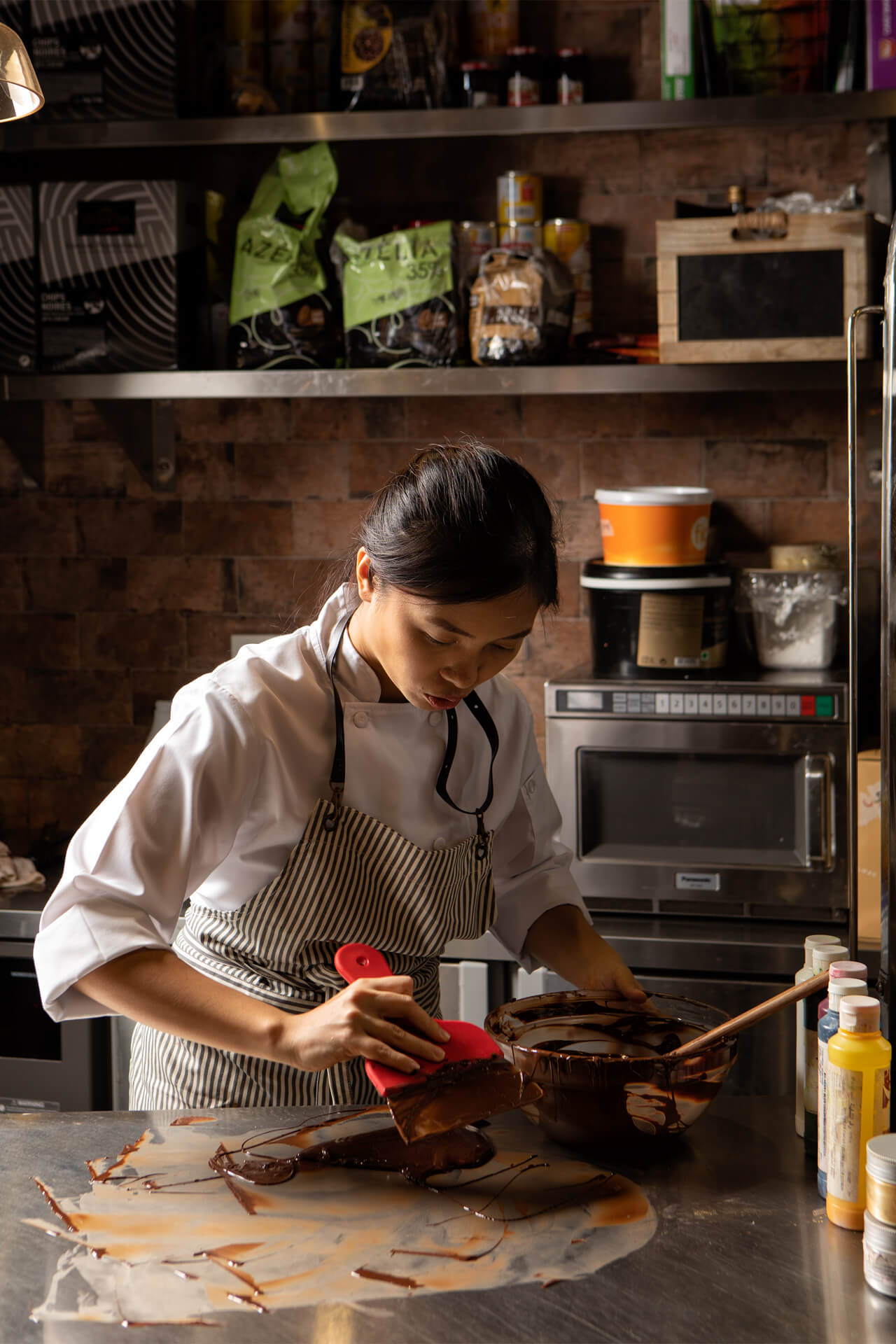 Chef Kristine Lotilla working with melted chocolate