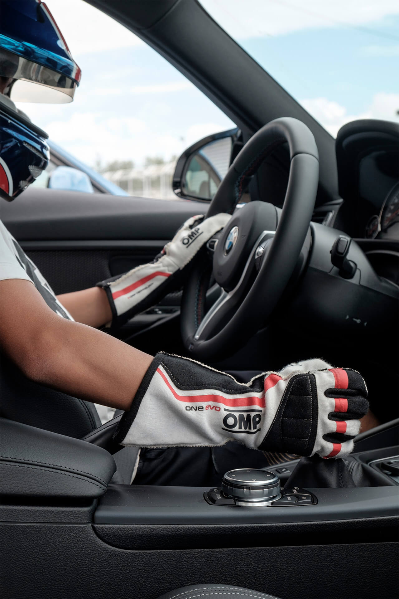 A driver with a helmet and gloves